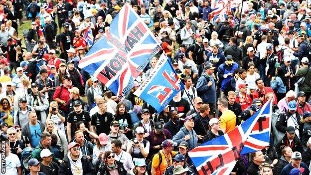Fans celebrate with Lewis Hamilton at Silverstone