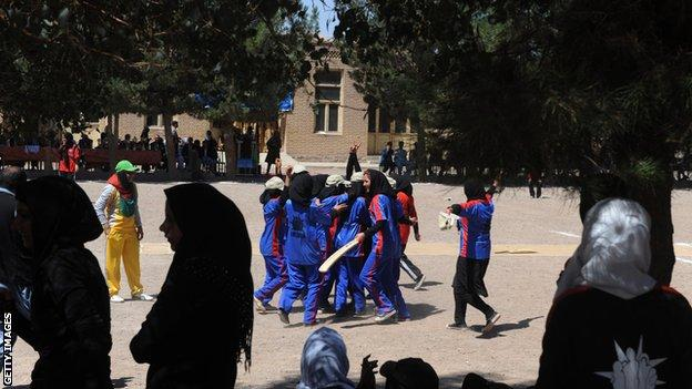 Afghan girls play cricket at a school in Herat in 2013