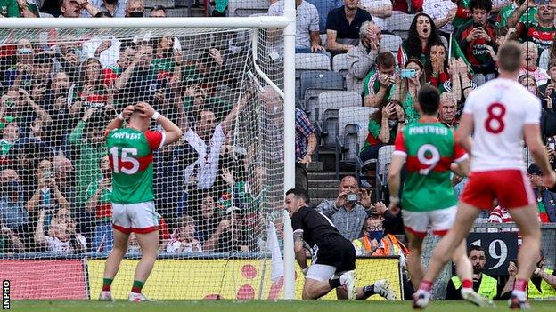 Ryan O'Donoghue holds his head in his hands after his penalty miss